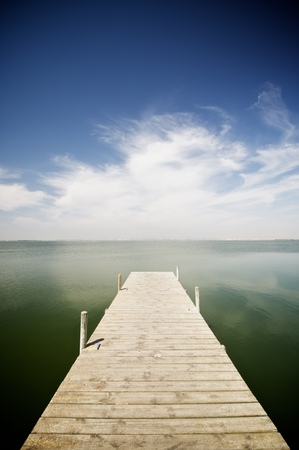 View of a wooden pier in Albufera lake, Valencia, Spain.