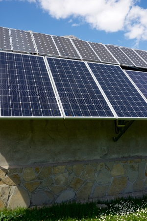 photocell: Photovoltaic panels on the roof of a hut in the Pyrenees, Aragues Valley, Aragon, Huesca, Spain. Stock Photo