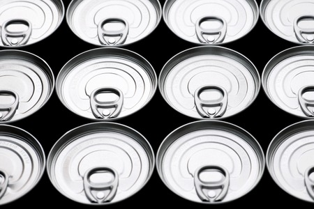 hermetic: Closeup of a group of aluminium cans.