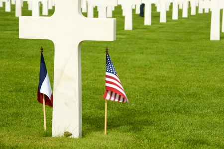 usa flags: White crosses in American Cemetery, Coleville-sur-Mer, Omaha Beach, Normandy, France. Editorial