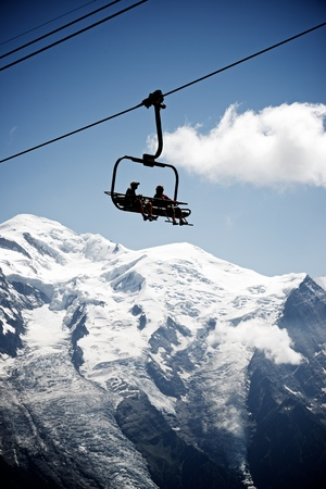 massif: Silhouette of a chairlift in Mont Blanc Massif, in the background is Mont Blanc peak, Alps, Chamonix, France Editorial