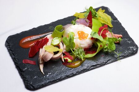 poached: Poached egg with chicken and vegetables. Stock Photo