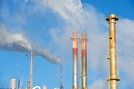contaminate: Smokestacks in a paper mill, Zaragoza Province, Spain.