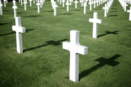 a memorial to fallen soldiers: White crosses in American Cemetery, Coleville-sur-Mer, Omaha Beach, Normandy, France. Editorial