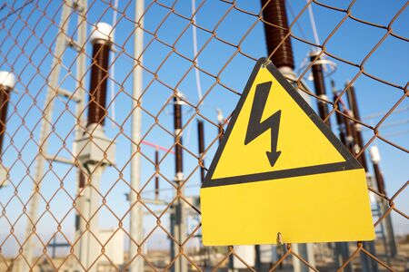 or electrocution: electrical hazard sign placed on a metal fence.
