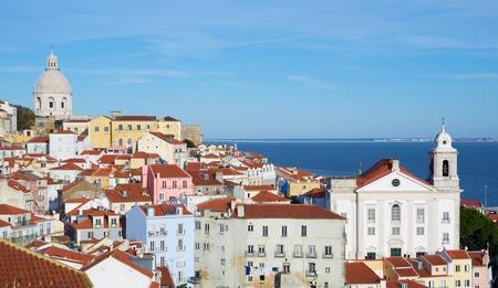 Alfama downtown, left Monastery os S. Vicente de Fora is located to the right Santo Estevao Church, Lisbon, Portugal. Stock Photo