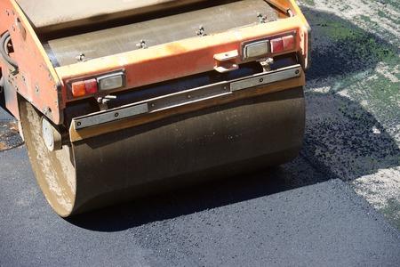 vibration: Heavy Vibration roller in asphalt pavement work. Stock Photo