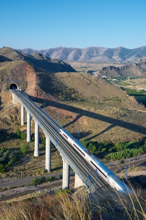 zaragoza: view of a high-speed train crossing a viaduct in Purroy, Zaragoza, Aragon, Spain. AVE Madrid Barcelona. Stock Photo