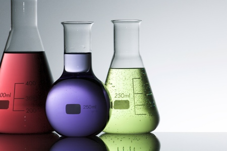 flasks: group of laboratory flasks with liquid inside Stock Photo