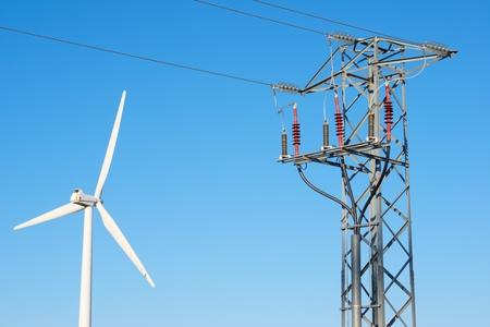 aragon: Windmill for electric power production and pylon, La Muela, Zaragoza Province, Aragon, Spain.