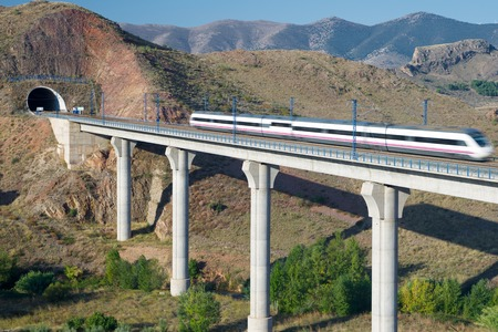 view of a high-speed train crossing a viaduct in Purroy, Zaragoza, Aragon, Spain. AVE Madrid Barcelona. Stock Photo