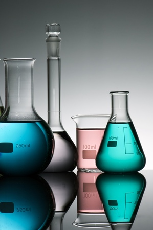 group of laboratory flasks with liquid inside Stock Photo