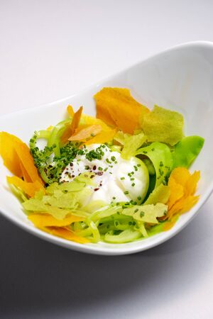 poached: Poached egg with vegetables.