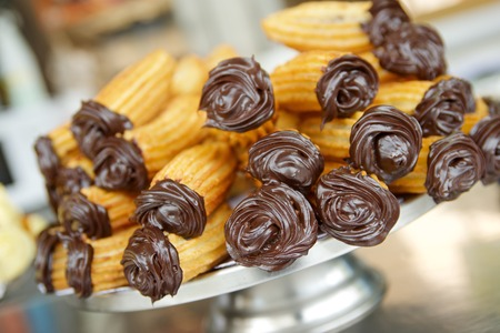 Group of typical churros at a stall, Spain. Archivio Fotografico