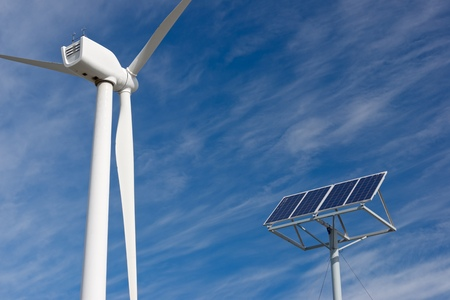 Windmill and photovoltaic panel for energy production, Zaragoza Province, Aragon, Spain. Stock Photo