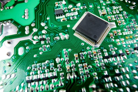 Chip close up on a integrated circuit. Stock Photo