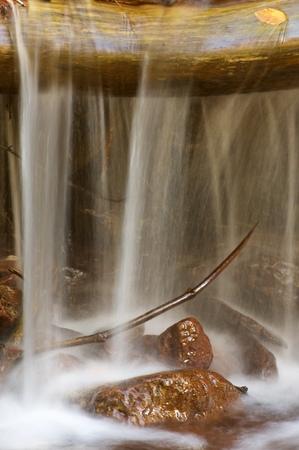 ordesa: Silky stream in a forest in autumn, Ordesa National Park, Pyrenees, Huesca, Aragon, Spain. Stock Photo