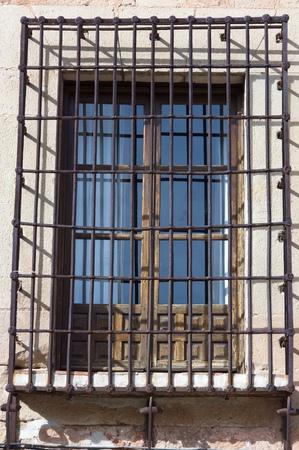 iron barred: Grid window in Sigenza, Guadalajara, Castilla La Mancha in Spain