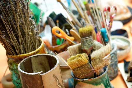 Group of brushes and tools n an artists workshop.