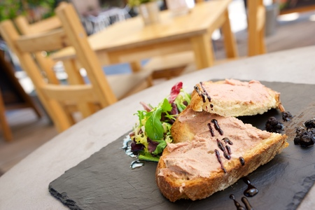 Pate toast on the terrace of a restaurant.