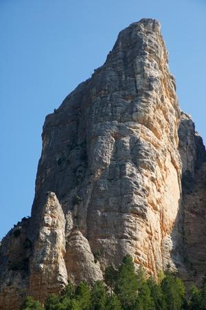 conglomerate: Rock wall, named as Masmut Rocks, in Penarroya de Tastavins, Teruel, Aragon, Spain.