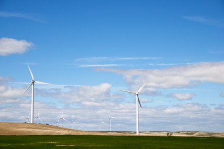 plowing: Windmills for electric power production, Zaragoza Province, Aragon, Spain. Stock Photo