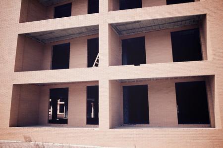 Facade of a residential building under construction.