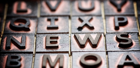 Rubber stamps creating the word news. Stock Photo