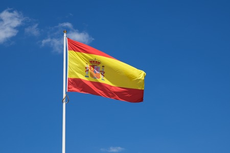 Close-up of the Spanish national flag waving.