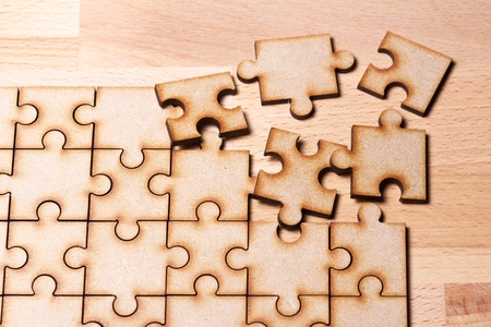 Close up of the pieces of a puzzle. Stock Photo
