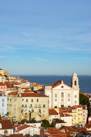 Alfama downtown and Santo Estevao Church in Lisbon, Portugal. Standard-Bild - 124235340