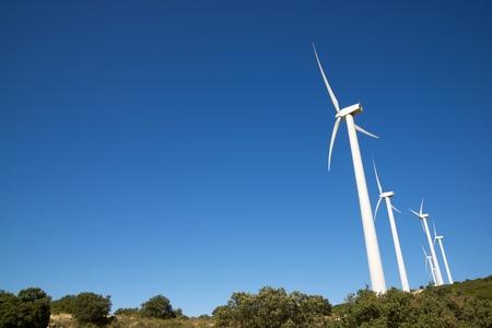 Windmills for electric power production, Zaragoza province, Aragon, Spain. Standard-Bild - 124235404
