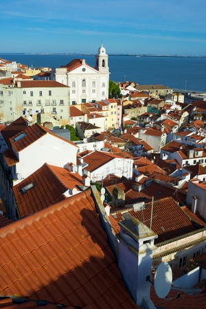 Alfama downtown and Santo Estevao Church in Lisbon, Portugal. Standard-Bild - 124235435
