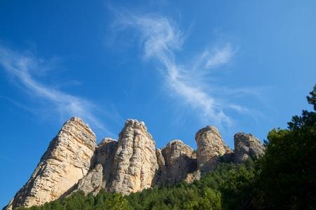 Rock wall, named as Masmut Rocks, in Penarroya de Tastavins, Teruel, Aragon, Spain. Standard-Bild - 124235447
