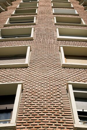 View of the facade of a brick building in Zaragoza, Spain. Stock Photo