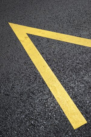 Yellow line painted on the asphalt.