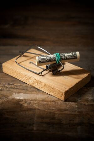 Dollar on a mouse trap.