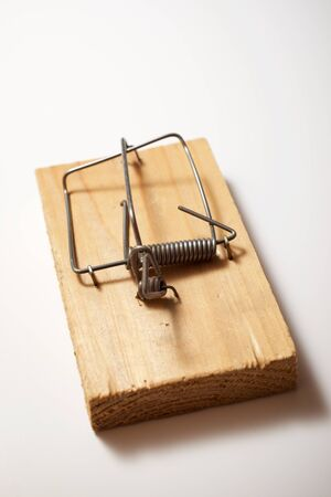 Mouse trap on a white table.