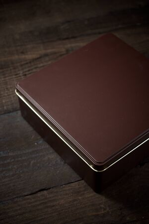 Brown metal box on a wooden table. 写真素材