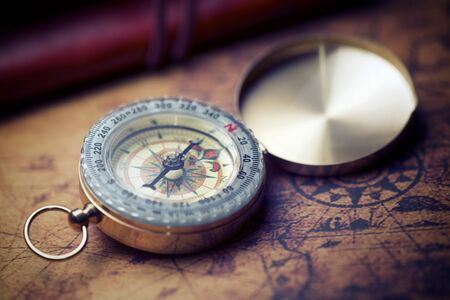 Vintage compass and old navigation map. Stockfoto