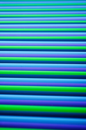 Drinking plastic straws on a black table. Stok Fotoğraf