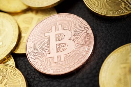 Bitcoins on a leather surface. Standard-Bild