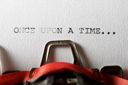 The sentence, once upon a time, written with a typewriter. Archivio Fotografico
