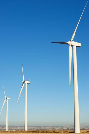 Windmills for electric power production, Zaragoza province, Aragon, Spain. Foto de archivo