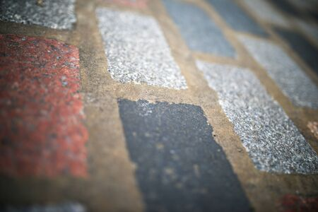 Floor of a street with stone tiles in London, England.
