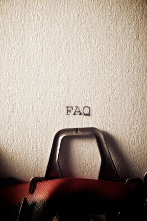 The abbreviation, FAQ, written with a typewriter.