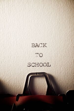 The sentence, Back to School, written with a typewriter.