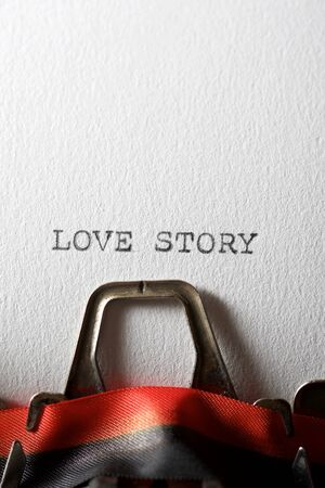 The sentence, Love Story, written with a typewriter.