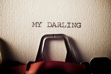 The sentence, My Darling, written with a typewriter.