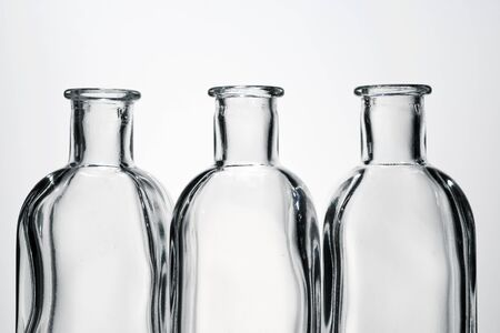 Glass bottles and white background.